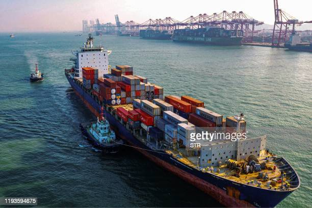 Cargo ship loaded with containers makes its way at a port in Qingdao in China's eastern Shandong province on January 14, 2020. - China's trade...
