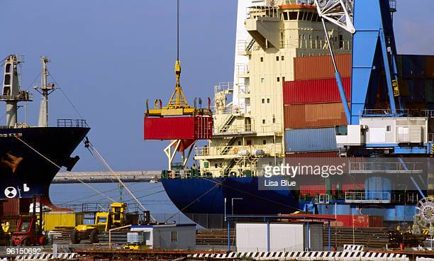cargo ship  loading container. - livorno stock pictures, royalty-free photos & images