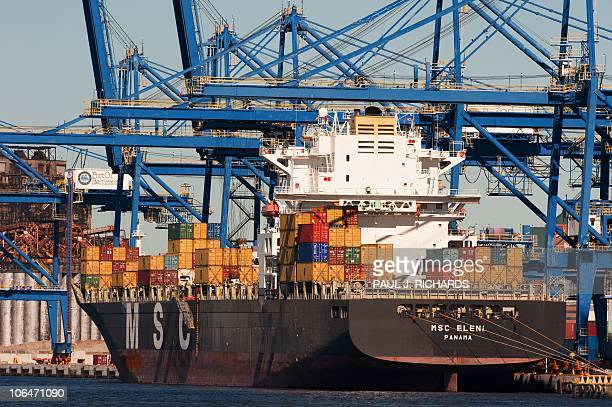 A cargo ship loads up as US Trade Representative Ron Kirk delivers remarks from the docks of Baltimore harbor on September 20 2010 about the...