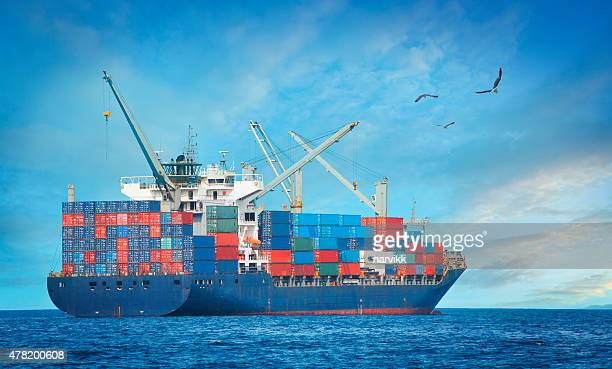 cargo ship on the sea - cargo ship stock pictures, royalty-free photos & images
