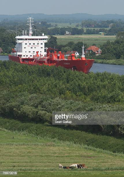 A cargo ship passes along the North Baltic Sea Canal August 3 2007 at Brunsbuettel Germany The canal first completed in 1895 is 99km long and...