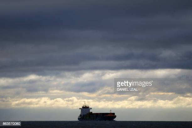 A cargo ship plies the Thames river near Canvey Island Essex on October 20 2017 A small island community in the Thames Estuary that voted massively...