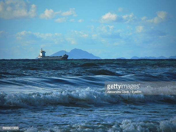 Cargo Ship Sailing On Sea Against Sky