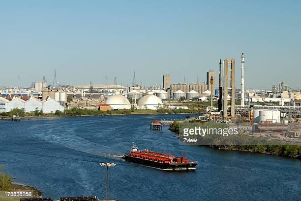 A cargo ship sailing out of a city port