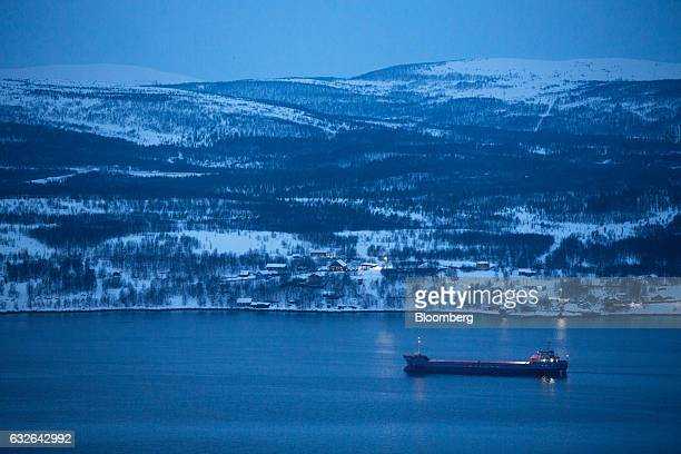 A cargo ship sails along an inlet of the Barents Sea close to the port of Murmansk on the eastern shore of Kola Bay in Murmansk Russia on Friday Jan...