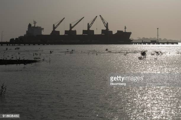 A cargo ship stands docked in the water at the commercial harbour in the port area of Bissau GuineaBissau on Monday Feb 12 2018 The International...