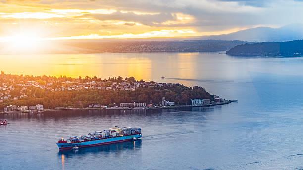 Cargo Ship Through Puget Sound In Sunset Wall Art
