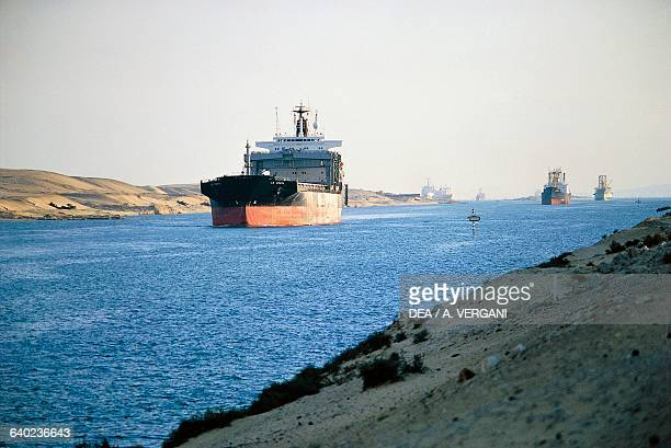Cargo ship transits the Suez Canal near Ismailia, Egypt.
