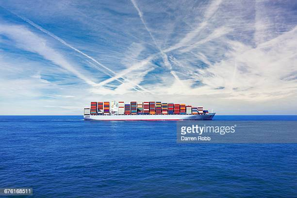 Cargo ship transporting containers across the sea