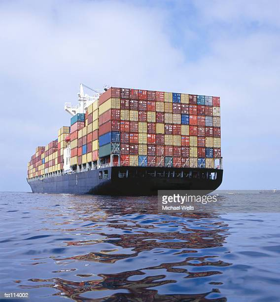 cargo ship transporting containers - barge stock photos and pictures