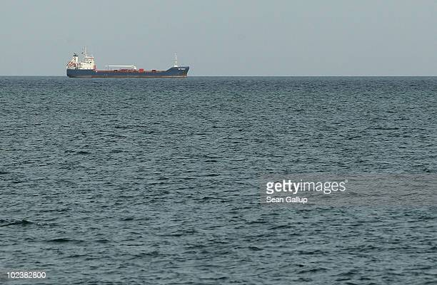 A cargo ship travels in the Gulf of Aden on June 24 2010 near the coast of Djibouti Town Djibouti The Gulf of Aden and waters off the Somali coast...