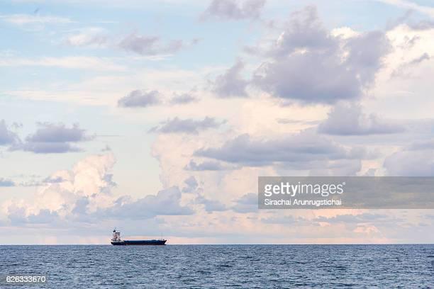 Cargo ship with pastel colour sky