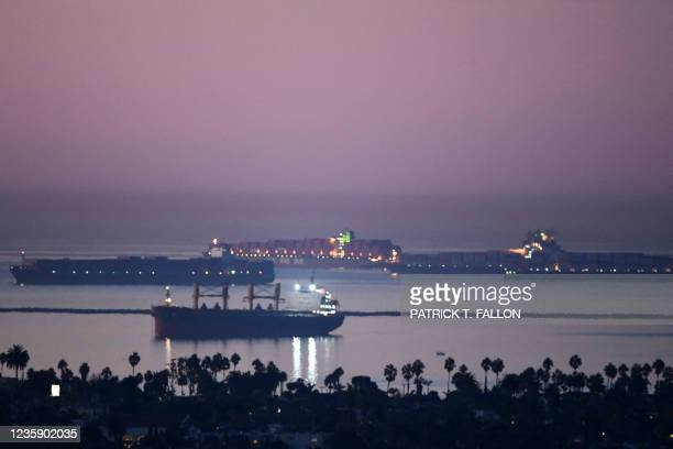 Cargo shipping container ships wait in the Pacific Ocean to enter the Port of Los Angeles and Port of Long Beach on October 15, 2021 as seen before...