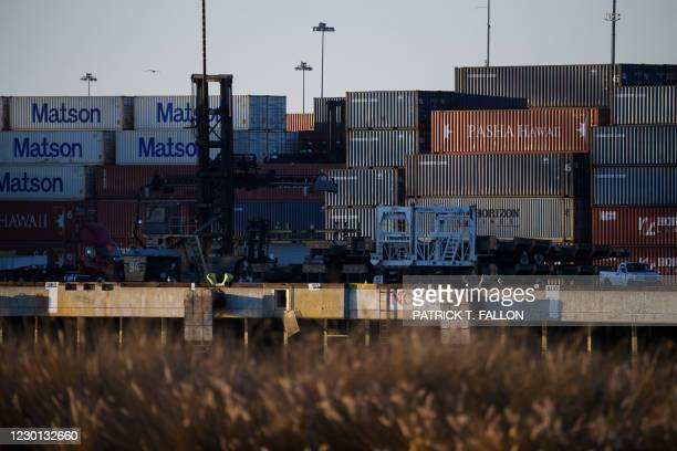 Cargo shipping containers in the Port of Long Beach on December 14, 2020 in Long Beach, California. - The bridge's higher clearance accommodates...