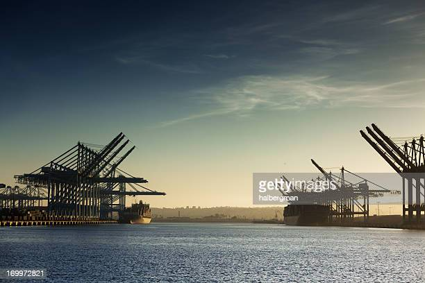 cargo ships and container cranes - long beach california stock photos and pictures