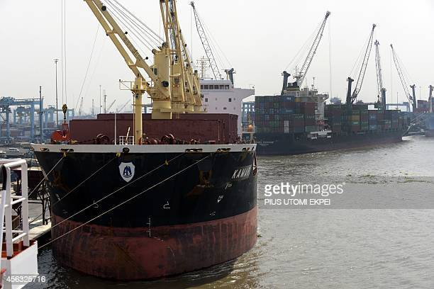 Cargo ships are docked at the Apapa Sea Port in Lagos on September 29 2014 Health officials have begun the screening of cargo ship crews transiting...