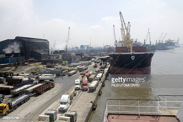 Cargo ships are docked at the Apapa Sea Port in Lagos on September 29 2014 Nigeiran Health officials have begun the screening of cargo ship crews...