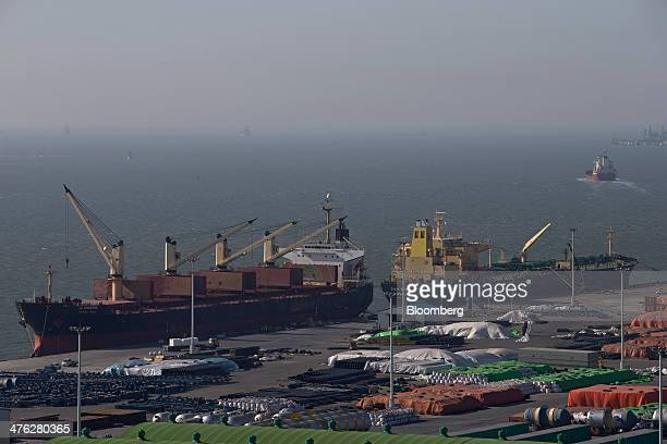 Cargo ships are moored at the Port of Pyeongtaek in Pyeongtaek South Korea on Sunday March 2 2014 South Koreas exports increased 16 percent in...