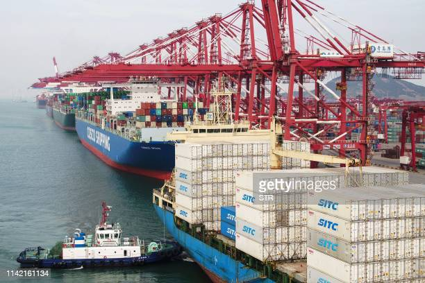 Cargo ships berth at a port in Qingdao in China's eastern Shandong province on May 8 2019 China's exports fell more than expected in April while...