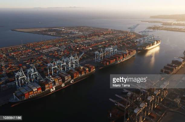 Cargo ships hold shipping containers as other containers sit at the Port of Los Angeles the nation's busiest seaport on September 18 2018 in San...