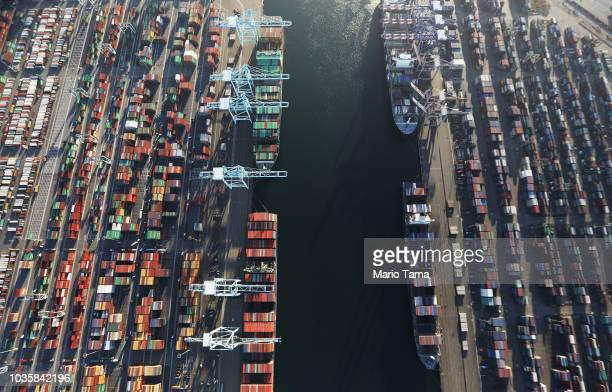 Cargo ships hold shipping containers as other containers sit at the Port of Los Angeles the nation's busiest container port on September 18 2018 in...