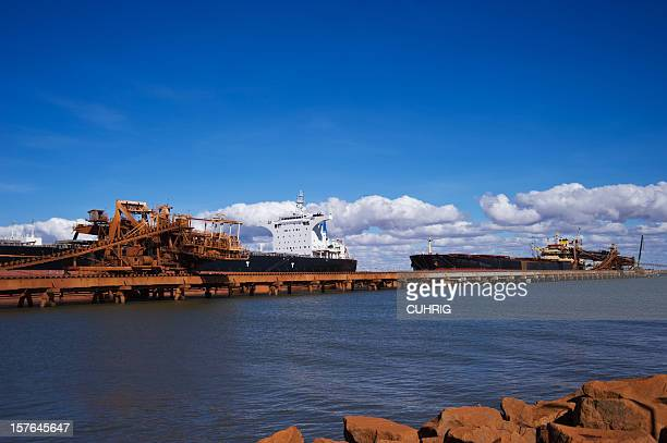 cargo ships loading pilbara iron ore - iron ore stock photos and pictures