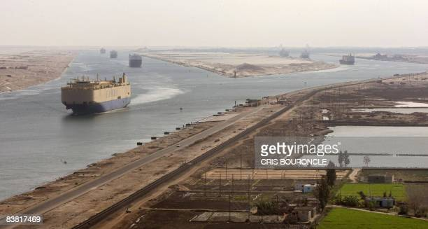 Cargo ships navigate in the Suez Canal between Port Said and Ismailia about 100 kms northeast of Cairo on November 24 2008 Increasingly brazen piracy...