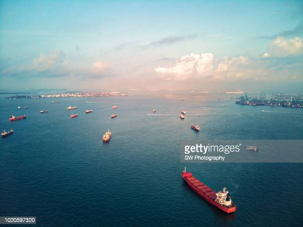 cargo ships on the ocean area near singapore - commercial dock stock pictures, royalty-free photos & images
