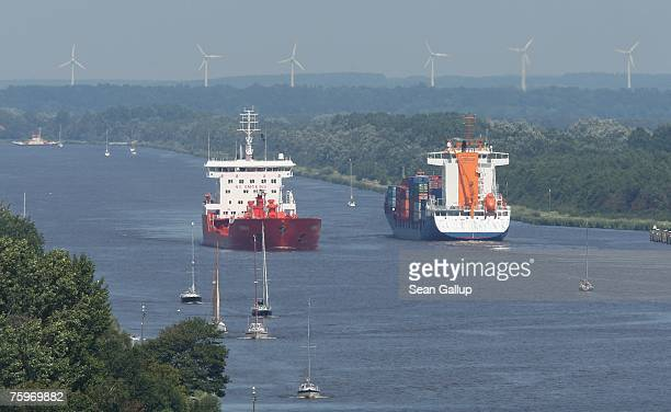 Cargo ships pass along the North Baltic Sea Canal August 3 2007 at Brunsbuettel Germany The canal first completed in 1895 is 99km long and connects...