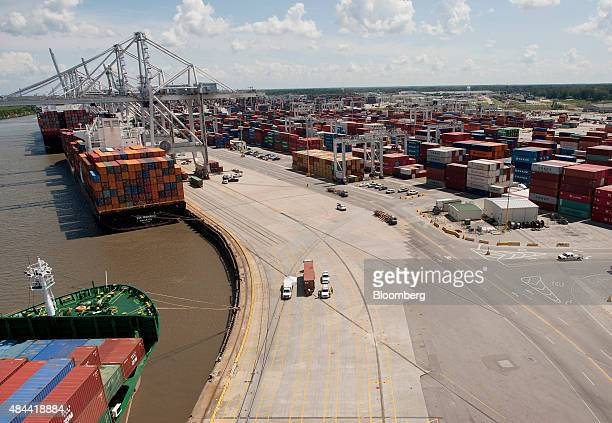 Cargo ships sit docked at the Port of Savannah in Savannah, Georgia, U.S., on Friday, Aug. 14, 2015. The trade deficit in the U.S. Widened in June as...