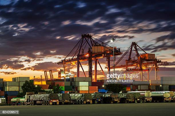 cargo shipyard in the harbor at sunset - ship funnel stock photos and pictures