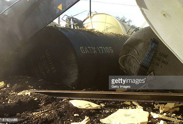 Cargo tanks lie at the scene of a train collision January 6 2004 in Graniteville South Carolina in this photo released by the US Environmental...
