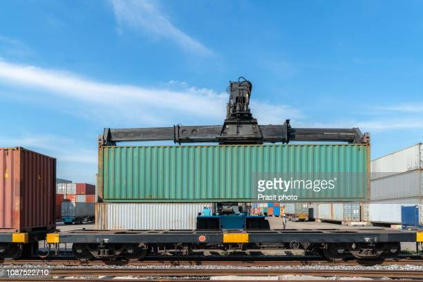 cargo train platform with freight train container at depot in port use for export logistics background. - 貨物用コンテナ ストックフォトと画像