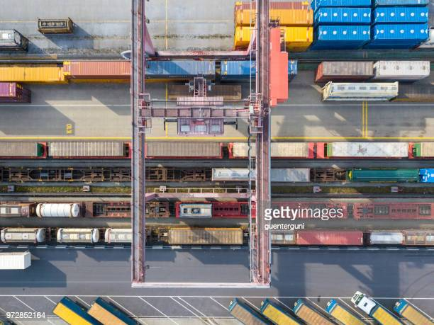 Cargo trains, trucks and a huge crane at freight terminal, Austria