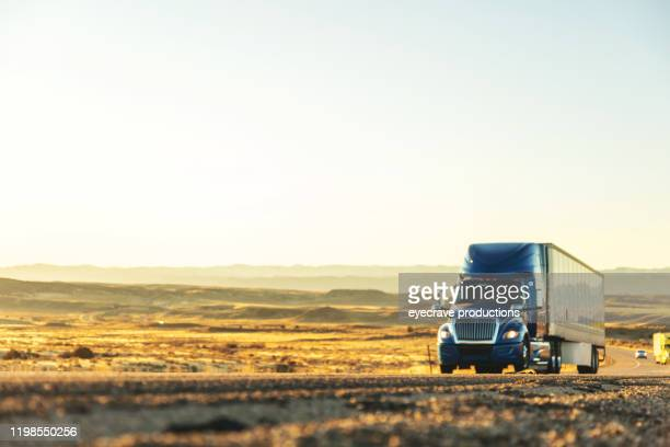 cargo transport long haul semi truck on a rural western usa interstate highway - golden hour stock pictures, royalty-free photos & images