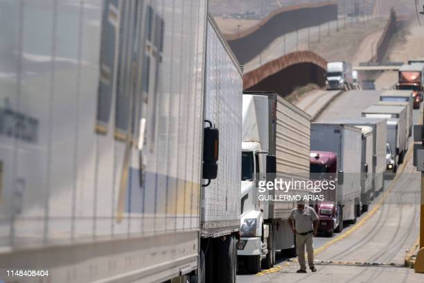 Cargo truck drivers line up to cross to the United States at Otay commercial crossing port in Tijuana, Baja California state, on June 6 Mexico. - The...