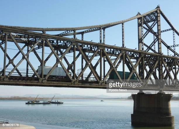 Cargo trucks cross the Sino-Korean Friendship Bridge from the northeastern China border city of Dandong into North Korea on Nov. 24, 2017. Roughly 70...
