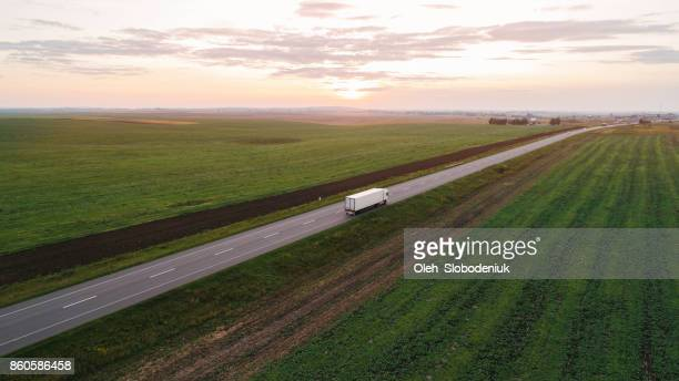 cargo trucks on the road in countryside in ukraine - rushing the field stock pictures, royalty-free photos & images