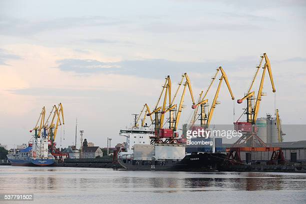 Cargo vessels sit at moorings beside loading cranes in the commercial sea port of Kaliningrad Russia on Tuesday May 31 2016 President Vladimir Putin...