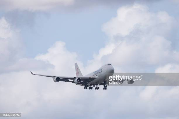 Cargolux Airlines International Boeing 747-4HQF landing in Amsterdam Schiphol International Airport in The Netherlands. The airplane's registration...