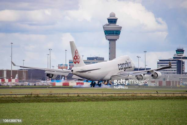 Cargolux Airlines International Boeing 7474HQF landing in Amsterdam Schiphol International Airport in The Netherlands The airplane's registration is...