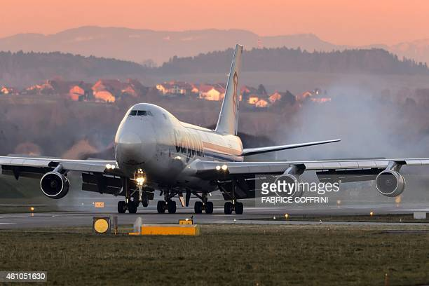 A Cargolux Boeing 747 cargo aircraft lands at Payerne airport on January 5 2015 The Boeing will carry solarpowered Solar Impulse 2 aircraft to Abu...