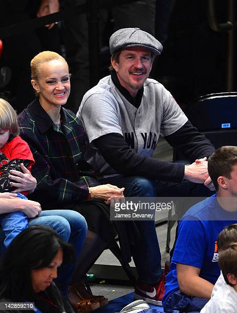 Cari Modine and Matthew Modine attend the Washington Wizards vs New York Knicks game at Madison Square Garden on April 13 2012 in New York City