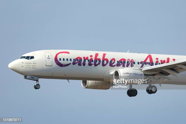 Caribbean Airlines Boeing 737800 commercial aircraft as seen on final approach landing at New York JFK John F Kennedy International airport in NY USA...