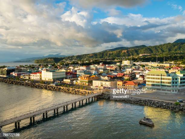 caribbean, antilles, dominica, roseau, view of the city at dusk - dominica stock pictures, royalty-free photos & images