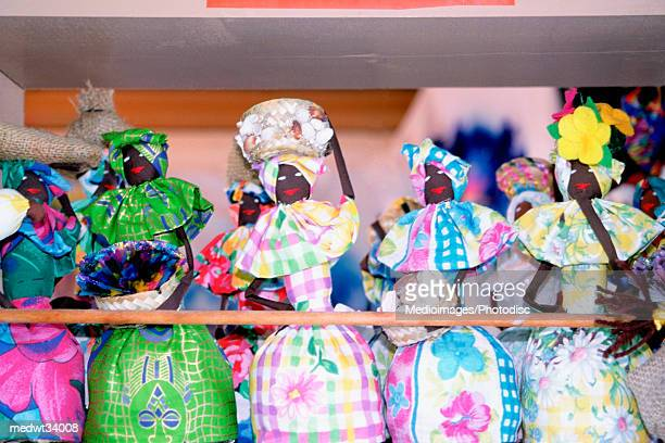 caribbean, bahamas, grand bahama island, lucaya, doll souvenir in a marketplace - grand bahama stock photos and pictures