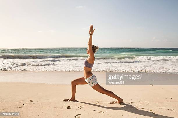 Caribbean, Barbados, Silver Sands beach, woman  practicing yoga