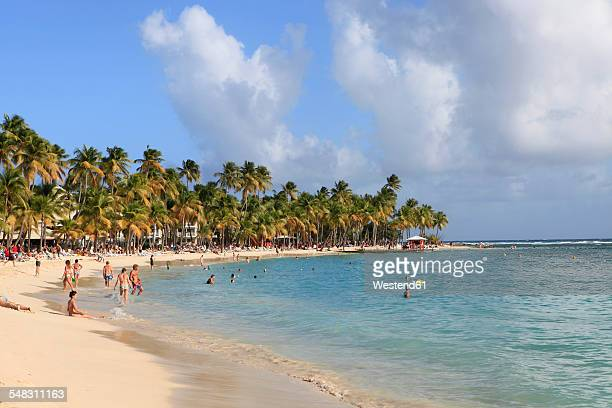 Caribbean, Guadeloupe, Grande-Terre, Tourists on the beach near Sainte-Anne
