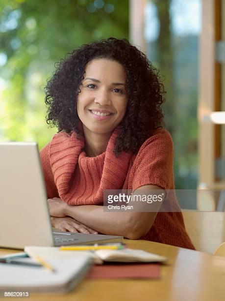 Caribbean woman using laptop