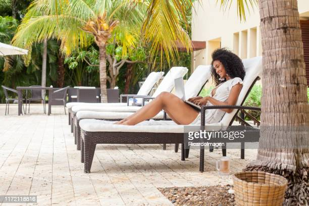 caribbean woman working from laptop - geographical locations stock pictures, royalty-free photos & images
